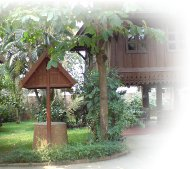 Lanna Style teak wood house in beautiful tropical gardens